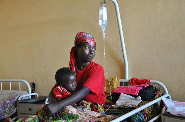 A mother and child recover from malaria in a Government hospital in Burundi. Photo via Flickr courtesy: Maria Cierna, Slovak Republic/UNDP.