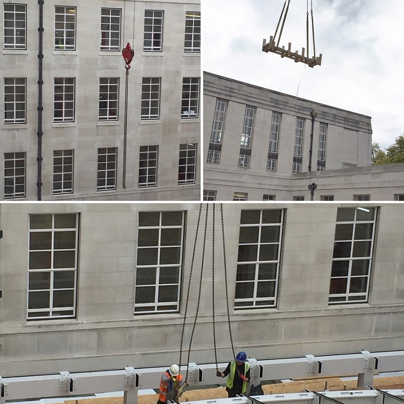 Craning a palette over the building to bring back more glass panels