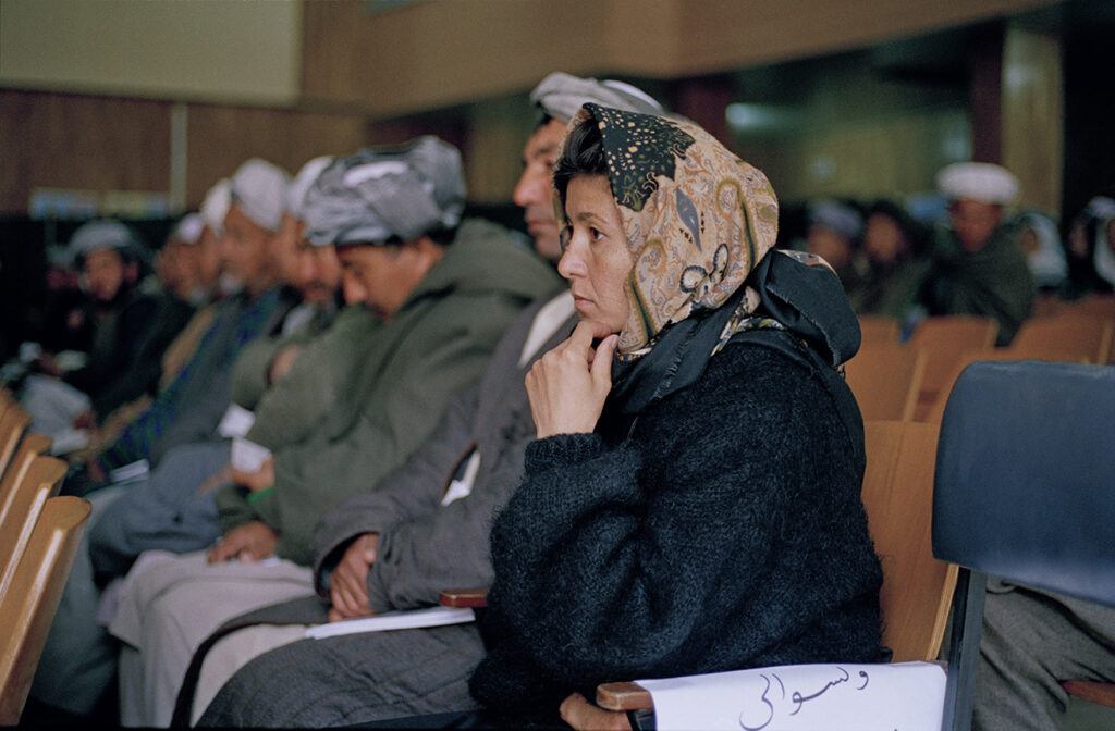 The lone face: local JIrga or council where women started taking part for the first time in 2002.